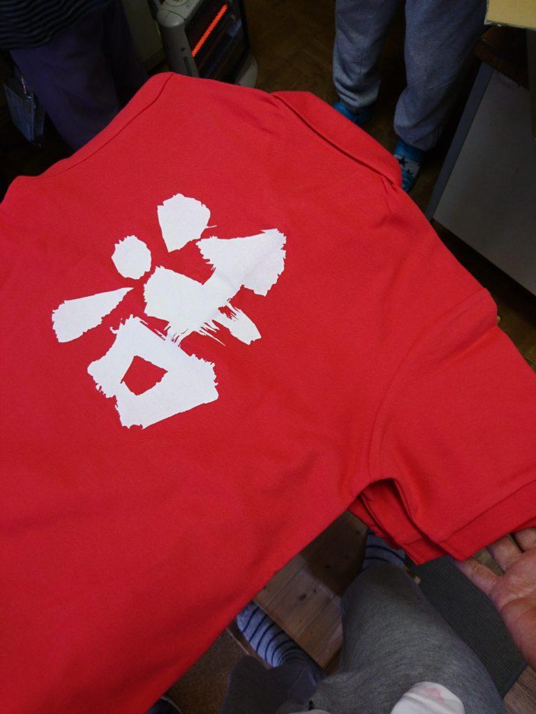 高蔵寺駅前の串旦那のポロシャツの画像