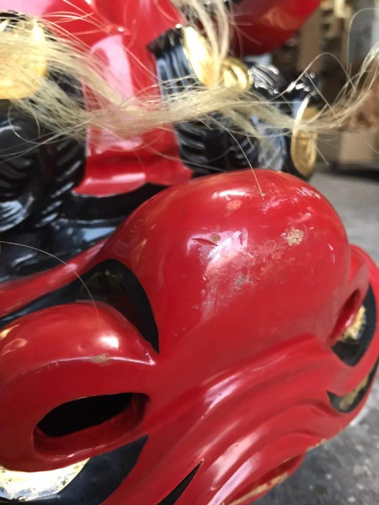 修理前の獅子頭の鼻の画像